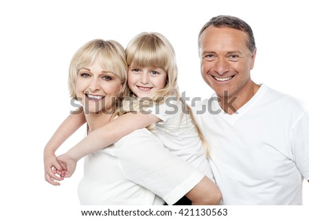 Joyful family of three posing to camera - stock photo