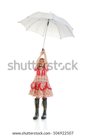 Joyful girl in a pink dress with an umbrella. Isolated on white background - stock photo