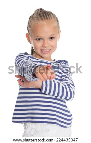Joyful girl points a index finger forward.Girl is six years old. - stock photo