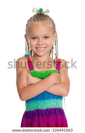 Joyful girl with crossed hands. Girl is six years old. - stock photo