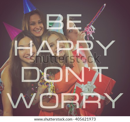 Joyful happy smiling teen girls have fun on birthday party, over black. Be happy, don't worry - stock photo