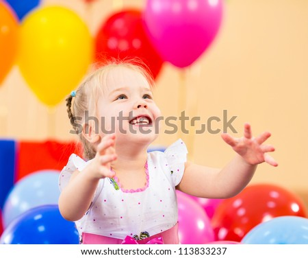 joyful kid girl on birthday party - stock photo