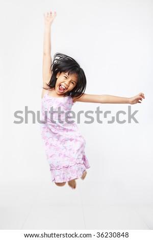 Joyful kid jumping high over white background. PS : motion blur - stock photo