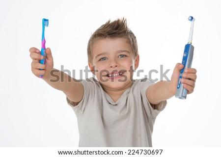 joyful kid raises his toothbrushes - stock photo