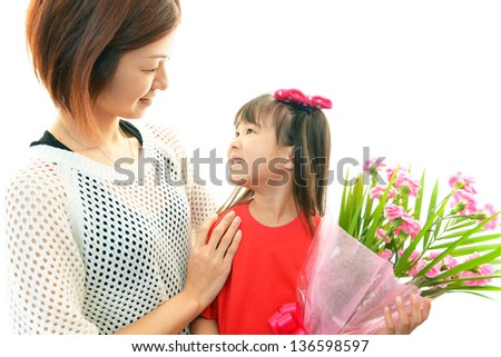 Joyful little girl holding flowers in hand - stock photo