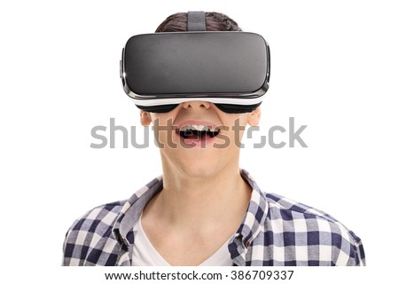 Joyful man using a VR headset and experiencing virtual reality isolated on white background - stock photo