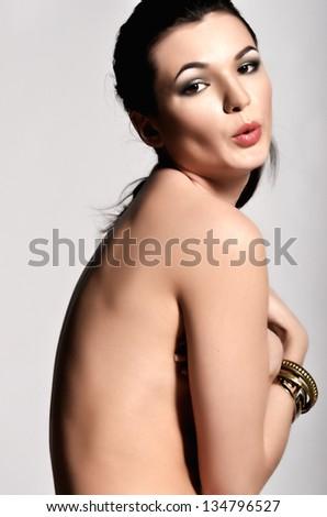 Joyful naked model. Photo from the back - stock photo