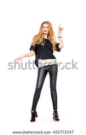 Joyful pretty woman wearing stylish clothes smiling and dancing. Full length portrait. Isolated over white.  - stock photo