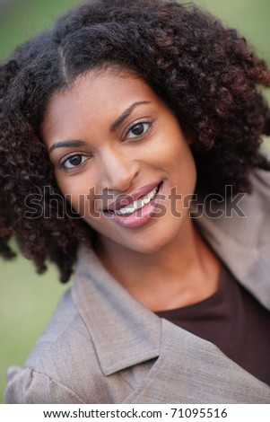Joyful woman smiling - stock photo