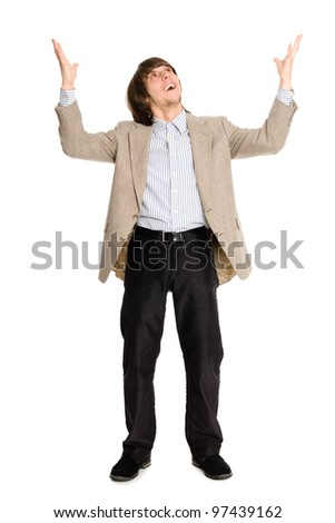 Joyful young business man with arms raised. - stock photo