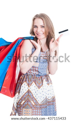 Joyful young caucasian doing shopping and paying with credit or debit card isolated on white background - stock photo