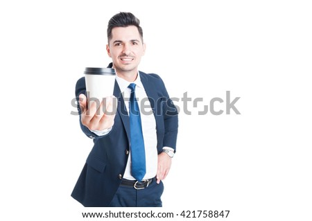 Joyful young salesman in suit giving a cup of coffee and looking happy with copyspace isolated on white - stock photo