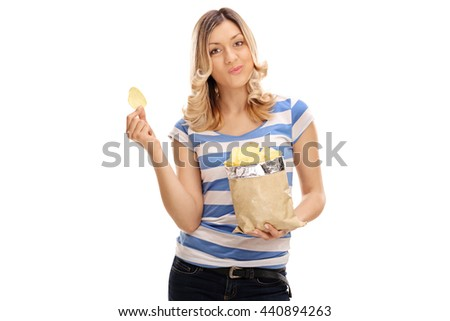 Joyful young woman eating potato chips isolated on white background - stock photo