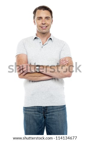 Joyous young man posing with his arms crossed isolated over white background - stock photo