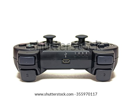 Joystick for video game consoles on white background - stock photo