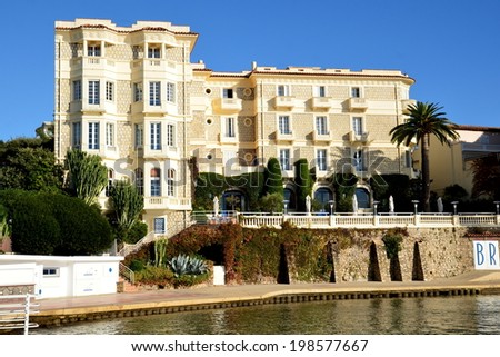 JUAN LES PINS, FRANCE-June 14: Belles rives hotel shown on june 14, 2014 in Juan les Pins, France. This 5-star hotel of 42 rooms knew how to keep its art deco style as knew him Scott Fitzgerald. - stock photo