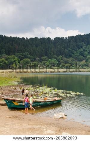 JUAYUA, EL SALVADOR - MAY 05: Lake deep in the forest called Laguna Verde on popular tourist route - Ruta de las Flores in El Salvador on May 05, 2014 - stock photo