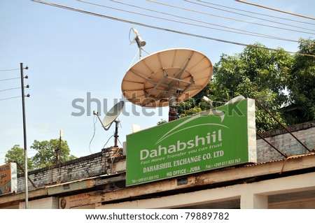 JUBA - JUNE 10: Dahabshiil has set up business on the main banking street in Juba, capital of South Sudan. According to the company, it is the largest African money transfer business. - stock photo