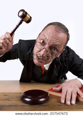 Judge furious, using his gavel - stock photo