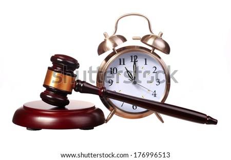 Judge gavel and Alarm Clock isolated on white background - stock photo