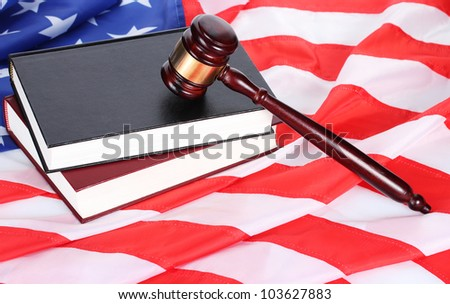 judge gavel and books on american flag background - stock photo