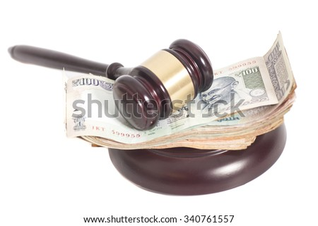 Judge gavel and Indian Currency Rupee bank notes on white background - stock photo