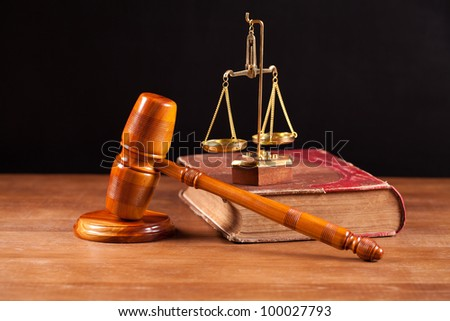 judge gavel and scales on the book - stock photo