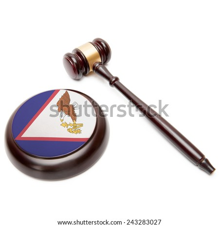 Judge gavel and soundboard with national flag on it - American Samoa - stock photo