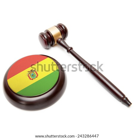 Judge gavel and soundboard with national flag on it - Bolivia - stock photo