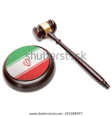 Judge gavel and soundboard with national flag on it - Iran - stock photo