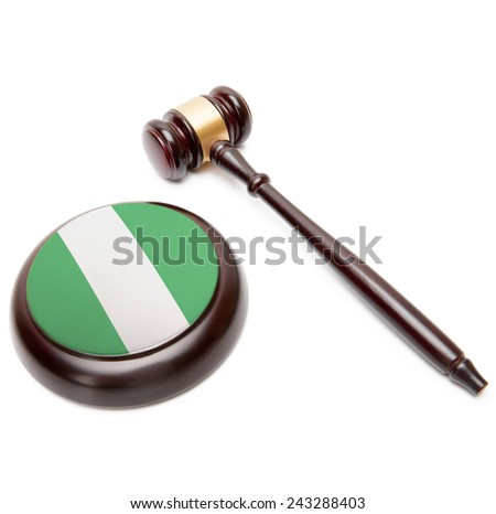 Judge gavel and soundboard with national flag on it - Nigeria - stock photo