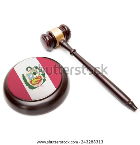 Judge gavel and soundboard with national flag on it - Peru - stock photo