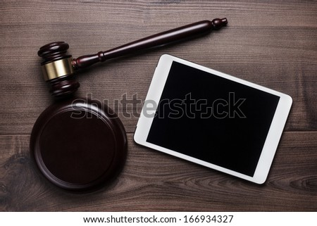 judge gavel and tablet computer on table cyber crime concept - stock photo