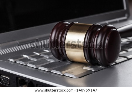 judge gavel on computer cyber crime concept - stock photo