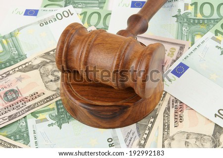 Judge gavel on dollar and euro banknotes background - stock photo