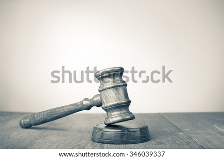 Judge gavel on table. Symbol of justice. Retro style sepia photo - stock photo