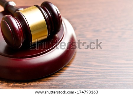 judge gavel on wooden background - stock photo