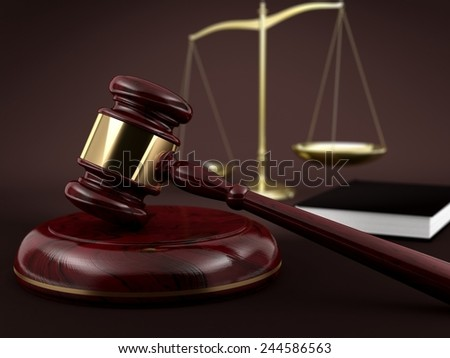 Judge gavel with book and gold scale in the background - stock photo