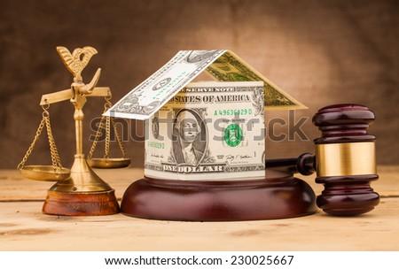 judge gavel with dollar money house closeup - stock photo