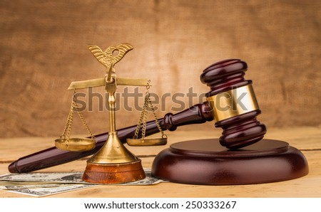 judge gavel with money  on wooden  table closeup - stock photo