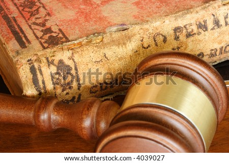 Judge hammer and old legal code - stock photo