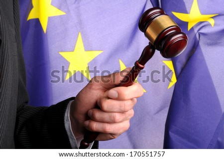 judge hold a gavel in front of the european flag - stock photo
