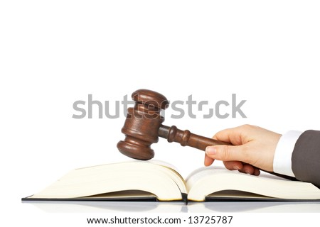 Judge holding a wooden gavel over the law book, reflected on white background - stock photo