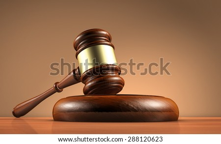 Judge, law, lawyer and legality concept with a close-up 3d render of a gavel on a wooden desktop with dark red-brown background. - stock photo