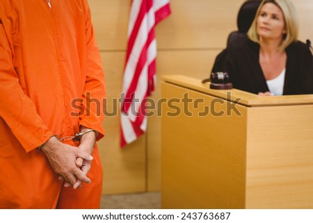 Judge looking the condemned prisoner in the court room - stock photo