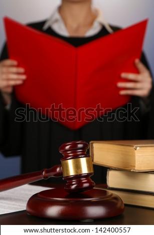 Judge read verdict on purple background - stock photo