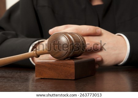 Judge. Referee hammer and a man in judicial robes - stock photo