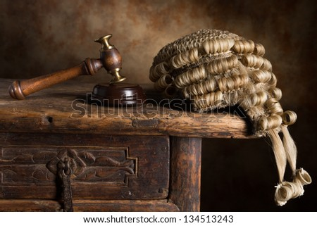 Judge's court wig and hammer or gavel - stock photo