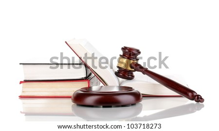 Judge's gavel and books isolated on white - stock photo
