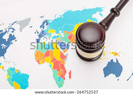 Judge's gavel and over world map - stock photo